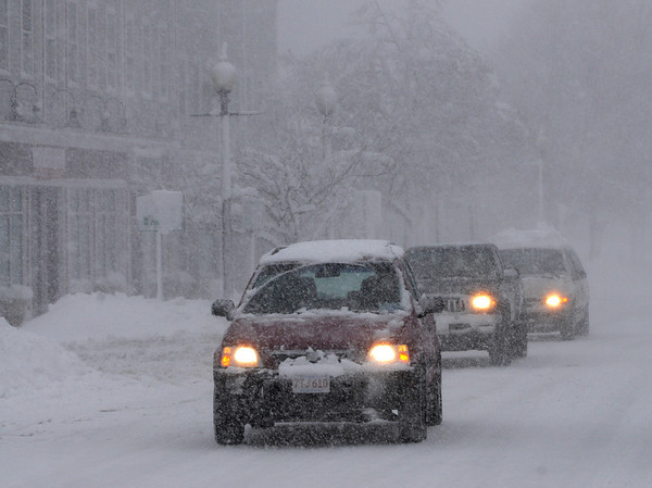 Danvers:<br /> Cars make their way through the wind driven snow on Maple Street, Danvers Wednesday morning.<br /> Photo by Ken Yuszkus/Salem News, Wednesday, January 13, 2011.