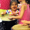 Middleton:<br /> Caitlin Kohn, 3, left, and her neighbor, Allison LeBlanc, 5, bang on a drum at the Flint Public Library during the presentation of Otha Day's Drumming to the Beat.<br /> Photo by Ken Yuszkus/Salem News, Tuesday, August 2, 2011.