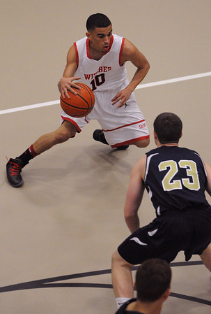 Salem:<br /> Salem's Marvin Baez moves the ball down court during the Malden Catholic at Salem boys basketball state tournament home playoff game.<br /> Photo by Ken Yuszkus/Salem News, Monday,  February 27, 2012.
