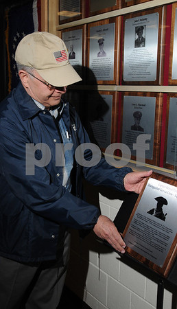 Peabody:<br /> Albert Mangone, brigadier general retired, lays the plaque commemorating a revolutionary soldier on a stand near the display case where it will eventually hang. The ceremony was at Peabody High School.<br /> Photo by Ken Yuszkus/Salem News, Friday, April 17, 2009.