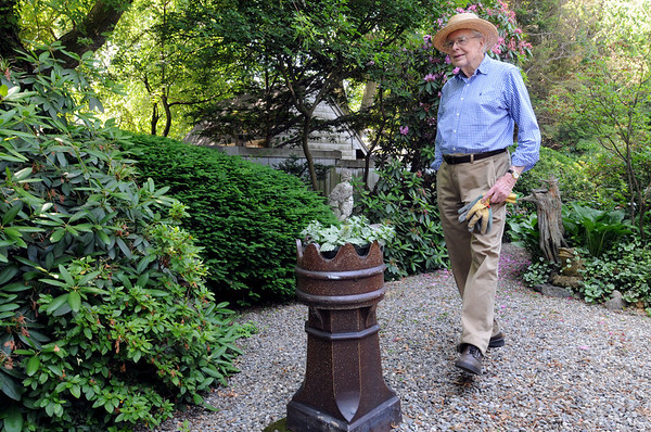 Danvers:<br /> John Burbidge walks through his garden in the back of his home. Cile and John Burbidge's Garden will be included on the Danvers Garden Tour this year.<br /> Photo by Ken Yuszkus/Salem News, Monday, June 20, 2011.