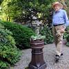 Danvers:<br /> John Burbidge walks through his garden in the back of his home. Cile and John Burbidge's Garden will be included on the Danvers Garden Tour this year.<br /> Photo by Ken Yuszkus/Salem News, Monday, June 20, 2011.