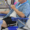 "Salem:<br /> Bill Woolley, assistant director at the Senior Center, uses a plastic shovel as a microphone while singing along with the Senior Tones at the Fathers Day luncheon held at the Senior Center. The theme of the luncheon was ""at the beach"". After lunch the Senior Tones, provided music of the 30s and 40s.<br /> Photo by Ken Yuszkus/Salem News, Tuesday, June 21, 2011."