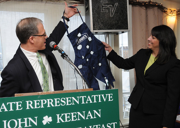 Salem:<br /> John Keenan gives Salem Mayor Kim Driscoll an tattered apron from Lowe's during John Keenan's annual St. Patrick's breakfast. <br /> Photo by Ken Yuszkus/Salem News, Friday,  March 16, 2012.