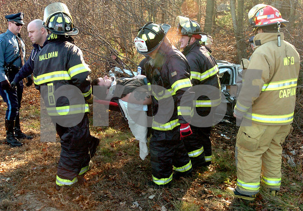 Beverly:<br /> The driver was extricated from the car at the scene of the one car accident on Route 128 northbound, just before exit 17 on Tuesday morning.<br /> Photo by Ken Yuszkus/Salem News, Monday November 18, 2008.