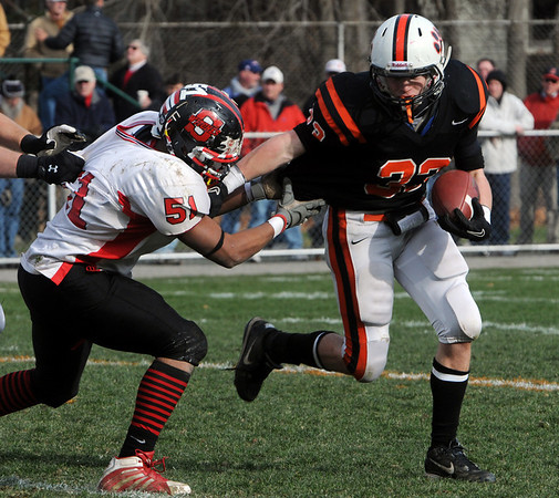 Beverly:<br /> Salem's Fernando Cabrara reaches for Beverly's Brendan Flaherty during the Salem at Beverly football game at Hurd Stadium.<br /> Photo by Ken Yuszkus/Salem News, Thursday, November 25, 2010.