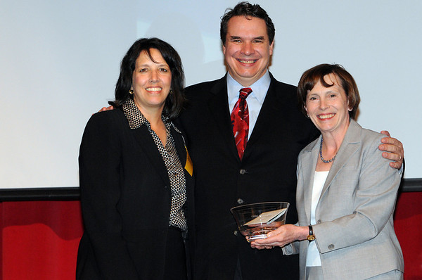 """Salem:<br /> Greg Mortenson, center, author of the best-selling book, """"Three Cups of Tea"""", accepts the Salem Award for Human Rights and Social Justice which was presented by Mayor Kim  Driscoll, left, and Patricia Maguire Meservey, president of Salem State College, before he spoke at Salem High School.<br /> Photo by Ken Yuszkus/Salem News, Saturday, May 1, 2010."""