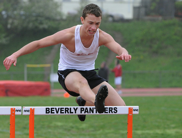 Beverly:<br /> Salem's Kyle Florence clears his final hurdle while competeing in the boys 400 yard hurdles during the Salem at Beverly track meet.<br /> Photo by Ken Yuszkus/Salem News, Tuesday, May 17, 2011.