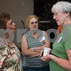 Salem:<br /> From left, Cathy Wallius of Gloucester, speaks with Mary Anne Killeen Silva of Danvers and Sue Decker Perry of Iowa, who are both 1959 Salem High graduates, during the Salem High 50th reunion picnic at Winter Island. Cathy Wallius was not a graduate of Salem High.<br /> Photo by Ken Yuszkus/Salem News, Sunday, July 12, 2009.