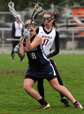 Beverly:<br /> Swampscott's Taylor Eaton, left, cradles the ball as Beverly's Katie Petrini comes from behind at the Swampscott at Beverly girls lacrosse game at Hurd Stadium.<br /> Photo by Ken Yuszkus/Salem News, Monday, May 16, 2011.