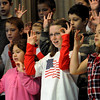 "Peabody:<br /> From left, Nada Hamze, Kaitlin Gorman, and Ciera Leissner use sign language with their fellow fourth graders on stage while singing ""God Bless the USA"" at the McCarthy Memorial School during the Veterans Day event at the school.<br /> Photo by Ken Yuszkus/Salem News,  Wednesday,  November 10, 2010."