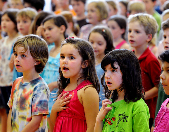 Wenham:<br /> From left, Jackson Contois, Lola Cambray, and Katarina Makogonov, all kindergarteners, sing God Bless America along with the 1st graders at the Memorial Day assembly at Buker School in Wenham on Friday afternoon.<br /> Photo by Ken Yuszkus/Salem News, Friday, May 27, 2011.