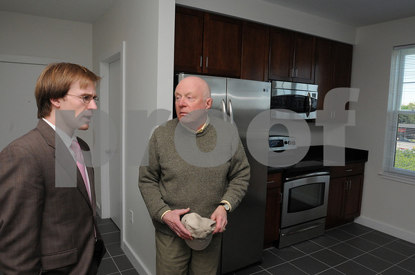 Salem:<br /> From left, Matt Picarsic of RCG, speaks with Bill Sano, who represents the Historic Derby Street Neighborhood Association, during the tour of the fourth floor apartments in the old Salem News building.<br /> Photo by Ken Yuszkus/Salem News, Monday, June 1, 2009.