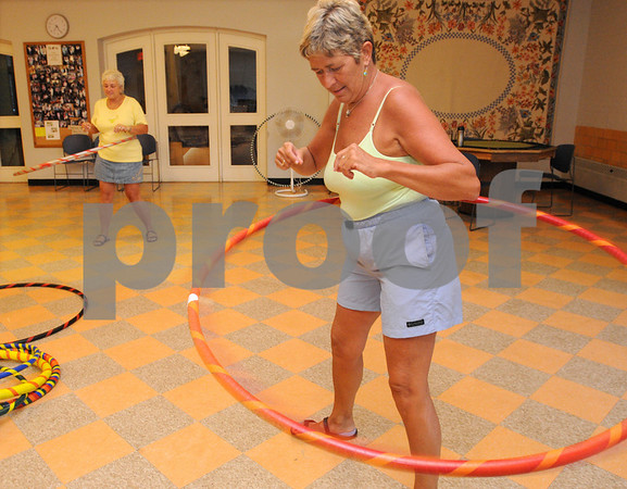 Ipswich:<br /> Irene Van Schyndel, instructor, leads with her hula hoop during the weekly women's hula hoop session in the Senior Center in town hall.<br /> Photo by Ken Yuszkus/Salem News, Monday, August 10, 2009.