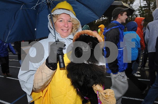 Danvers:<br /> Jeannette MacDowell and her dog Belle prepare to start on their 3-mile walk in the rain during the 22nd Annual Walk for Hospice from Cronin Memorial Stadium<br />  at St. John's Prep.<br /> Photo by Ken Yuszkus/Salem News, Sunday October 18, 2009.