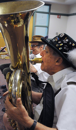 Hamilton:<br /> Gordon Bowan, left, and John Evans, of the Bavarian Hofbrau Band, played at the Hamilton-Wenham Library during the Octoberfest held on Friday morning. Hidden is Bob Lynn, the other member of the band.<br /> Photo by Ken Yuszkus/Salem News, Friday, October 7, 2011.