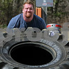 Wenham:<br /> David Hansen lifts and flips a 650lb tractor tire as cameramen capture the feat. The Discovery Channel film crew were filming at Gull Pond at Gordon College.<br /> Photo by Ken Yuszkus/Salem News, Friday, April 17, 2009.