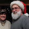 Salem:<br /> Erin Griffin, left, and John O'Brien with his Santa hat, enjoy the festivities at the Salem Children's Charity Annual Christmas Party held at Victoria Station restaurant.<br /> Photo by Ken Yuszkus/Salem,  News, Tuesday,  December 14, 2010.