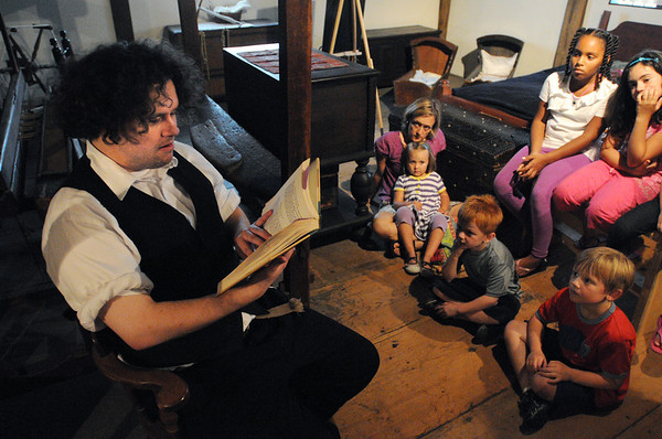 Salem:<br /> Matt Taylor reads some curious tales aloud for the young inside the Witch House. The event was part of Heritage Days.<br /> Photo by Ken Yuszkus/Salem News, Monday, August 8, 2011.
