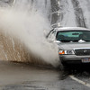 Beverly:<br /> A car drives through a large puddle at the end of Beverly-Salem bridge late Wednesday morning.<br /> Photo by Ken Yuszkus/Salem News, Wednesday, February 2, 2011.