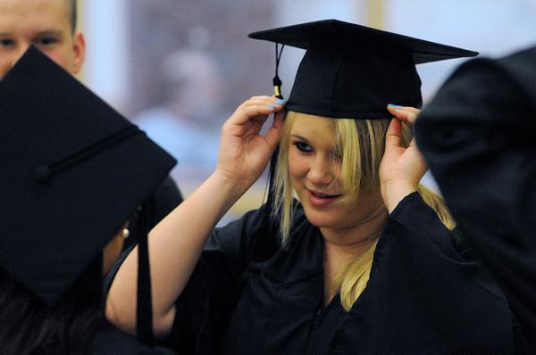 Ipswich:<br /> Jessica Neenan her mortarboard on her head before the start of the Ipswich High School graduation.<br /> Photo by Ken Yuszkus/Salem News, Sunday, June 3, 2012.