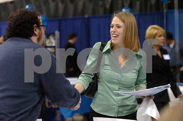 Salem:<br /> Stephanie Read, right, from Beverly, a senior at Salem State College, talks with Josh Carpenter from Health & Education Services, Inc. at the job fair at the college.<br /> Photo by Ken Yuszkus/Salem News, Monday, March 30, 2009.