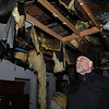 Salem:<br /> Will Perone talks about the fire at his 98 Washington Square residence last Friday afternoon as he walks through his fire ravaged apartment.<br /> Photo by Ken Yuszkus/Salem News, Wedesday, March 23, 2011.