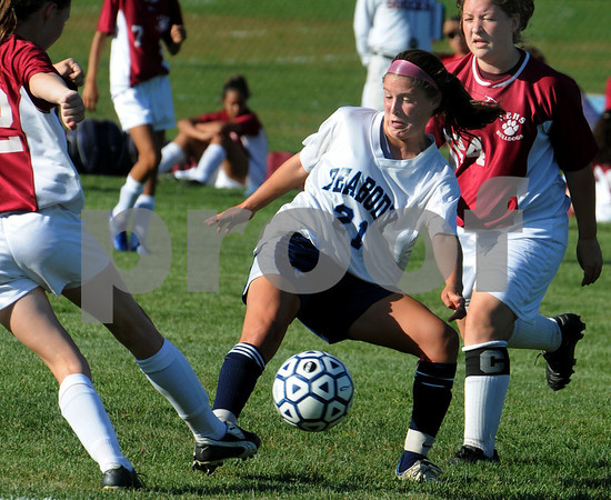 Peabody:<br /> Peabody's Hayley Dowd wrestles with the ball at the Lynn English at Peabody girls soccer game.<br /> Photo by Ken Yuszkus/Salem News, Tuesday, September 15, 2009.