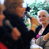 Beverly:<br /> Seated on the right, Patricia Mattatall, left, and Louise Maskell listen to Lyn and Jan DeBenedictus, of American Guild of Variety Artists, sing at the Senior holiday party at the Beverly Senior Center on Thursday.<br /> Photo by Ken Yuszkus/Salem,  News, Thursday,  December 16, 2010.