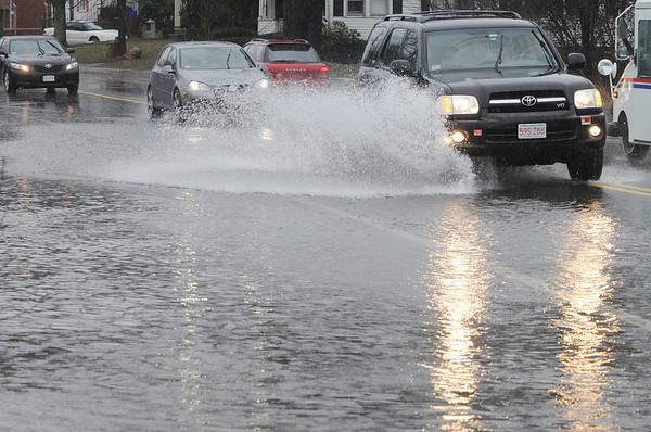 Salem:<br /> Cars drive through the flooded section of Loring Avenue near leggs Hill Road.<br /> Photo by Ken Yuszkus/Salem News, Monday, March 15, 2010.