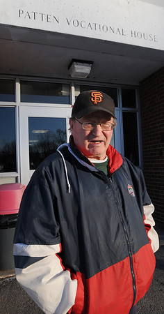 Beverly:<br /> Sports fan, Jack Dean, stands near the entrance to Patten Wing at back of Beverly High School which is the entrance basketball fans enter the school and walk a long distance to the field house. Jack Dean is a 64-year-old man with an artificial leg who says he can no longer go to Beverly High School basketball games because of construction at the school.<br /> Photo by Ken Yuszkus/Salem Newsa, January 7, 2010.