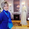 Beverly:<br /> Barbara Bourdo designed the displays for the historical exhibit about the Gold Coast summer houses for the rich that have become buildings at Endicott college. The display in the background is a 1904 dress loaned by the Wenham Museum.<br /> Photo by Ken Yuszkus/Salem News, Monday, February 14, 2011.