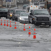 Peabody:<br /> Cars drive through the flooded section of Central Street at Walnut Street.<br /> Photo by Ken Yuszkus/Salem News, Monday, March 15, 2010.