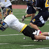 Peabody:<br /> Bishop Fenwick's Andrew Ruby falls to the ground while fighting for the ball during the St. Mary's of Lynn at Bishop Fenwick boys lacrosse game.<br /> Photo by Ken Yuszkus/Salem News, Monday, May 14, 2012.