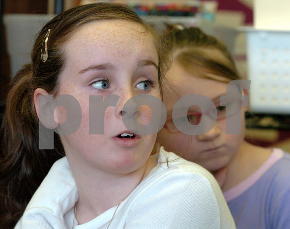 Peabody:<br /> Hannah Hollow talks about the inauguration. She is a fifth grade student in Nancy Manning's class at the McCarthy school. In the background is Nicole Malvarosa.<br /> Photo by Ken Yuszkus/Salem News, Friday,  January 16, 2009.