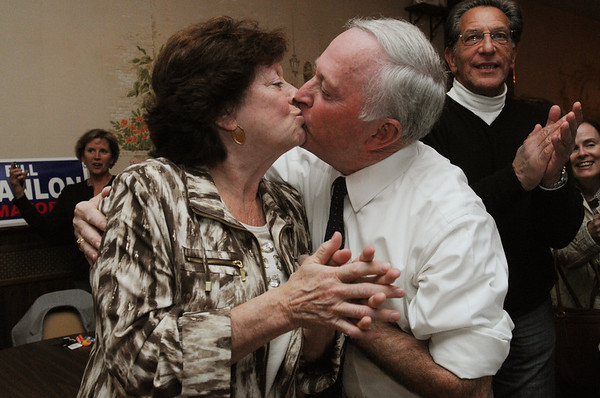 Beverly:<br /> Mayor Bill Scanlon, center, kisses his wife Louise, left, when he won the Beverly mayorial race. Larry Herman, is on the right.<br /> Photo by Ken Yuszkus/Salem News, Tuesday, November 8, 2011.