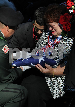 Beverly:<br /> Elizabeth Crawford, Stephen's mother receives the flag that draped the casket of her son from Brigidier general Tom Semonite at the end of the graveside funeral service at St. Mary's Cemetery. Stephen R. Fortunato, was killed in Afghanistan by a roadside bomb.<br /> Photo by Ken Yuszkus/Salem News, Friday, October 24, 2008.