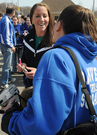 Danvers:<br /> Meghan Duggan, 2010 U.S. women's hockey silver medalist from Danvers, signs autograpghs and poses for photos before the start of the parade in her honor.<br /> Photo by Ken Yuszkus/Salem News, Sunday, March 21, 2010.