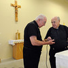 Peabody:<br /> Father Felix Prior, left, and Father Herbert Jones check the microphone system at the new location for the Carmelite Chapel. While the mall chapel is being renovated, the chapel has been moved to the old Office Depot.<br /> Photo by Ken Yuszkus/Salem News, Thursday, April 8, 2010.