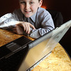 Salem:<br /> Max McAuliffe, 9, wants to collect 100 or more useable laptops for homeless children in the motels to use to surf the Internet safely, and for parents to search for jobs.<br /> Photo by Ken Yuszkus/Salem News, Monday, November 28, 2011.