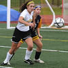Peabody:<br /> Bishop Fenwick's Julia Pierce chases the loose ball near the goal during the Arlington Catholic at Bishop Fenwick girls soccer game.<br /> Photo by Ken Yuszkus/Salem News, Monday, October 3, 2011.