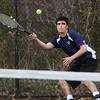 Swampscott:<br /> Swampscott's Val Temin smacks the ball back during the Peabody at Swampscott boys tennis match at Swampscott Middle School tennis courts.<br /> Photo by Ken Yuszkus/Salem News, Monday, April 9, 2012.