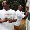 "Salem:<br /> Celtics Glen ""Big Baby"" Davis, left, and former Celtics Cedric Maxwell, sign a banner while at the Plummer Home for Boys for the dedication of the basketball court that the Celtics helped build along with the NFL quarterback Steve Young's Foundation. They also shot a few hoops with the kids.<br /> Photo by Ken Yuszkus/Salem News, Monday August 16, 2010."