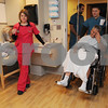Salem:<br /> Patient John Spagnoli of Swampscott, is wheeled into his new private room, which was one of 32 private rooms that were being occupied as part of a $30-million renovation project at the North Shore Medical Center. Christopher Johansen, support associate, is wheeling him into his new room. Alyssa Hanson, RN, is there to help him settle in.<br /> Photo by Ken Yuszkus/Salem News, Wednesday,  January 7, 2009.