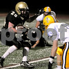 Peabody:<br /> Bishop Fenwick's Dan Kennedy runs with the ball trying to sidestep Arlington Catholic's defense.  Arlington Catholic played football against Bishop Fenwick at Bishop Fenwick.<br /> Photo by Ken Yuszkus/Salem News, Friday, October 31, 2008.