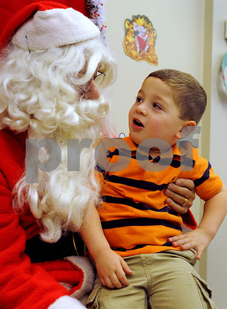 Peabody:<br /> Spencer Scully, 3, of Peabody, sits in Santa's lap and tells him what he would like for Christmas. Santa arrived in the morning at the Breakfast With Santa at the South Branch Library.<br /> Photo by Ken Yuszkus/Salem News, Wednesday December 10, 2008.