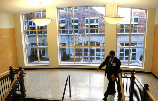 Beverly:<br /> The large window that looks out toward the courtyard is seen from the stairway on the second floor. It was the back drop for the ribbon cutting ceremony for the new Beverly High School on Friday morning.<br /> Photo by Ken Yuszkus/Salem News,  Friday,  November 19, 2010.