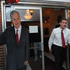 Beverly:<br /> Mike Cahill leaves Mayor Bill Scanlon's election party at the Vittori-Rocci Post walking by a full size painting of Mayor Bill Scanlon on the front steps. He had just congratulated Mayor Bill Scanlon for winning the Beverly mayorial race.<br /> Photo by Ken Yuszkus/Salem News, Tuesday, November 8, 2011.