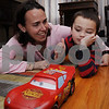 Beverly:<br /> Dawn Coback and her son, Jake, play with his toy car on the floor of their home. Jake was diagnosed with autistm as a baby, and the family spent tens of thousands of dollars to pay for therepy, which has really made a difference. Now, she started a nonprofit organization to give other families that can't afford it a chance to have the therapy. <br /> Photo by Ken Yuszkus/Salem News, Wednesday, April 8, 2009.