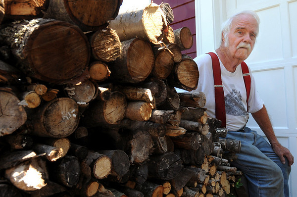 Wenham:<br /> Harold Boothroyd, is retiring after 40 years as the Wenham's lumber surveyor and measurer of tree and bark. He is sitting on his log pile at his home.<br /> Photo by Ken Yuszkus/Salem News,Thursday, July 8, 2010.